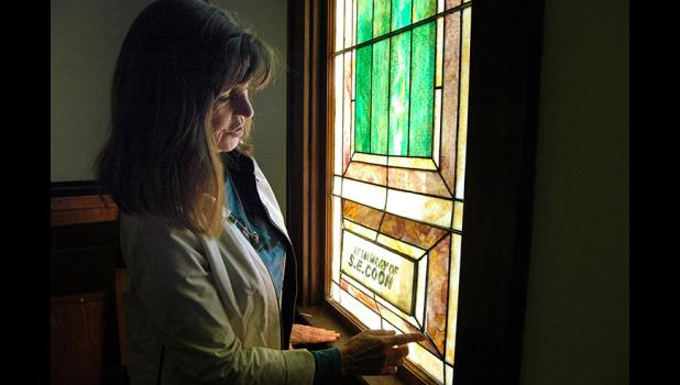 Semke, vice chair of Pleasant Hill Memorial Inc., shows where stained glass inside the church needs releaded. Pleasant Hill Memorial Inc. recently gained IRS-approved nonprofit status in order to better solicit donations. ANDREW McGINN | JEFFERSON HERALD