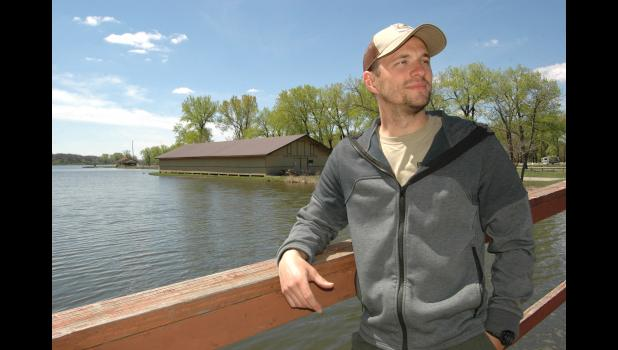 Joe Allen, pictured with Spring Lake's historic roller skating rink in the background, has taken over as the resident park ranger. He succeeds Pat Soukup as park ranger at Spring Lake, which now generates $160,000 annually in camping revenue. ANDREW McGINN | JEFFERSON HERALD