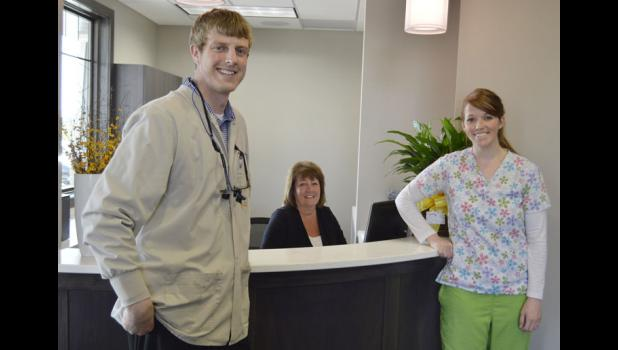 Dr. Keith Van Beek (left), secretary Kristy Scheuermann and dental assistant Jessica Lestina stand at the front desk of the newly opened Jefferson Family Dentistry on Tuesday, the first day the office was open for business. MATTHEW REZAB | JEFFERSON HERALD