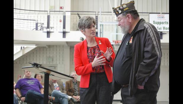 U.S. Sen. Joni Ernst, R-Iowa, addresses a concern Friday by Louis Swanson, of Jefferson, that the U.S. Department of Veterans Affairs won't recognize the use of Agent Orange during the Vietnam War on Guam, where he was stationed. Ernst led a panel discussion at the Greene County Community Center with veterans from across Iowa. ANDREW McGINN | JEFFERSON HERALD