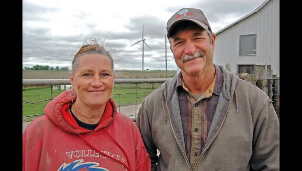"""""""We're just trying to survive,"""" says Denise Gannon (left), pictured with husband Hugh. Their small, independent hog operation near Rippey is a snapshot of the pork industry before the mid-1990s, when a rapid shift to fewer and much larger operators enabled the U.S. to become a net exporter of pork."""