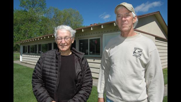 Jerry Kelley (left), of Jefferson, pictured with Greene County Conservation Director Dan Towers outside the lakeside shelter house at Spring Lake, recently gave $50,000 to benefit the park. He also plans to leave land to the county that would expand Henderson Park south of Jefferson by as much as 15 acres. ANDREW McGINN | JEFFERSON HERALD