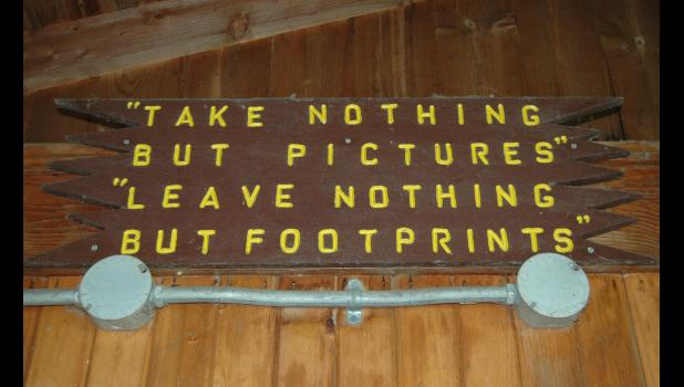"A sign in the lakeside shelter house at Spring Lake urges visitors to respect nature. ""You can talk to a lot of people, it's the cleanest park that is,"" says Jerry Kelley, whose recent gift of $50,000 will expand the park's most popular shelter house. As a whole, Spring Lake now generates $160,000 annually in camping revenue for the county. ANDREW McGINN 