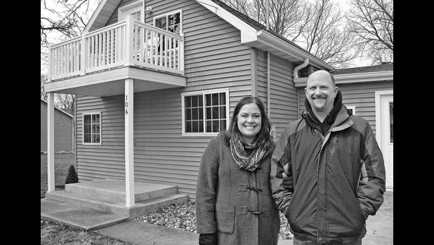 "Ashley and Chad Schwander initially bought the empty house next door to them on Vest Street in Jefferson ""just to make the neighborhood nicer."" It's now listed on Airbnb. ""We thought one more place to stay around here wouldn't be bad,"" Chad says. ANDREW McGINN 