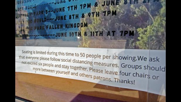 Social distancing guidelines are posted outside the Sierra Community Theatre, which is trying to lure moviegoers back with reduced admission prices. ANDREW McGINN | JEFFERSON HERALD