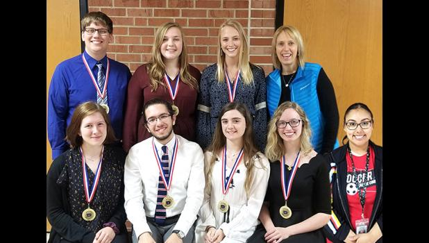 Seven graduating seniors at Greene County High School were awarded the Iowa Seal of Biliteracy, a new honor recognizing them as proficient in two or more languages. Pictured, from left, at top: Arthur Bardole, Kara Reed, Brittney Daniel and Spanish teacher Amy van der Meer. From left at bottom: Claire Teusch, Demir Bulut, Sydney Roberts, Morrgan Zmolek and Spanish teacher Maribel Hernandez. CONTRIBUTED PHOTO
