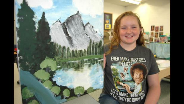 """I didn't think I'd watch him like I do,"" Alivya Smith says of Bob Ross, whose old TV show has found a new generation of fans via Netflix and the internet. With the blessing of Paton-Churdan art teacher Tami Minnehan, 10-year-old Alivya  completed a Ross-style landscape painting in the final weeks of school. ANDREW McGINN 