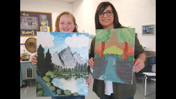 Minnehan (right) urged Alivya to paint a second landscape all her own before school got out. Alivya now wants to turn a closet at home into an art studio.