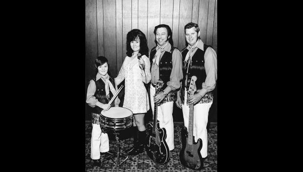 Drummer Hank Muzney began playing with his family's beloved country band, Don and the Country Bells, at age 6.