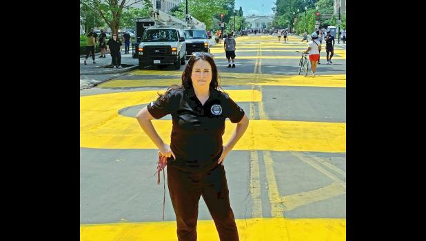 "Jefferson native Nicole Peckumn stands Friday near the newly christened Black Lives Matter Plaza in Washington, D.C., where her boss, Mayor Muriel Bowser, had the words Black Lives Matter painted in bright yellow on the section of 16th Street leading to the White House. ""Maybe,"" Peckumn says, ""this is our generation's moment in time to stop talking and do something."""