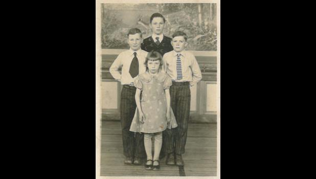 The Hillman siblings pose for picture day in the Dana school gym during the 1934-35 school year. (From left) Ivan, Wayne, Max and Martha Hillman.