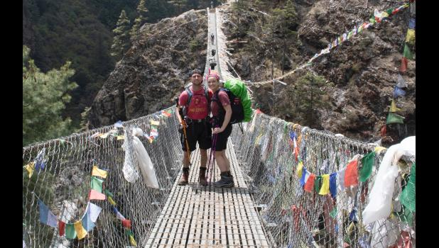 Chase Flack (left) and girlfriend Hannah Woods stop for a photo on a suspension bridge on the eight-day hike last month from Lukla in Nepal to the Mount Everest Base Camp.