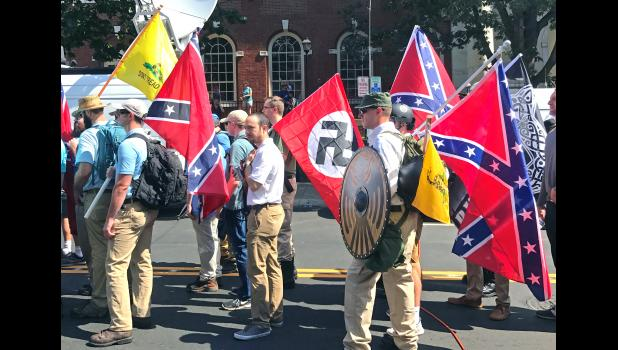 "Very fine people: Men holding Nazi, Confederate and ""Don't Tread on Me"" flags are pictured in Charlottesville, Va., in 2017."