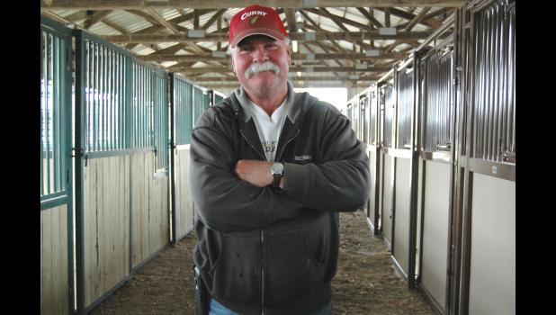 """Had I not had a granddaughter, I wouldn't have done any of this,"" Gene Hicks says of the new horse stalls (some of which are pictured at right) at the Greene County Fairgrounds. Hicks wrangled the money and materials needed to add 18 bigger stalls. (And, just for the record, Hicks says that if he knew his picture was going to be taken, he would have worn his cowboy hat instead.) ANDREW McGINN 