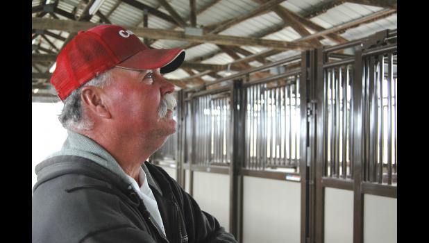 "Gene Hicks talks about the improvements that were recently made to the south horse barn at the Greene County Fairgrounds. He had the idea, but the project became a reality thanks to 75 individual donations. ""There are a lot of damn good people,"" he says. ANDREW McGINN 