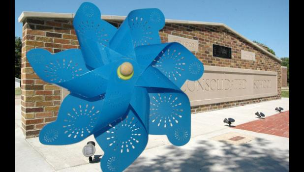 A pinwheel was left last week at the Rippey School Memorial in memory of Keith Devilbiss, the volunteer mason who recently completed the memorial. Devilbiss, 77, was killed June 15 when his ATV collided with a pickup truck in Rippey. ANDREW McGINN | JEFFERSON HERALD