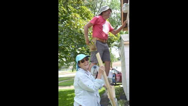 Gary and Linda Coldiron work on the exterior of a home in Jefferson. The Coldirons belong to Habitat for Humanity's RV Care-A-Vanners, traveling across the country in their RV helping to build homes.