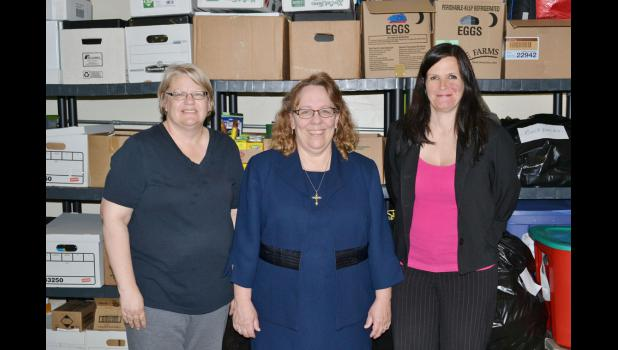 Pam Mentzer (from left), Julie Poulsen and Teresa Lansman founded the Homeless Teens Coalition in 2012 after noticing a special need locally for homeless teens. The group also works with other organizations such as the food pantry and Adopt-A-Family, which provides gifts and food over Christmas. Besides thestash of donations in the Catholic church in Jefferson, they also have a closet of supplies at the high school.