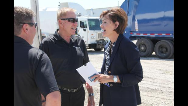 Scranton Manufacturing CEO and founder John McLaughlin (center) talks Wednesday with Lt. Gov. Kim Reynolds at the groundbreaking of the company's expansion project.