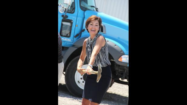 Lt. Gov. Kim Reynolds helps Scranton Manufacturing on Wednesday break ground for an expansion.