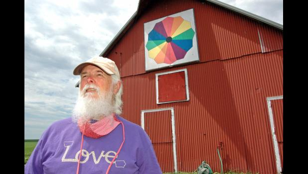 """""""Tolerant was my father,"""" says Dale Hanaman, pictured outside his barn near Rippey. """"To be anti-racist is what we need to be about."""" A retired United Methodist minister, Hanaman has been leading silent marches each week around the Greene County courthouse in solidarity with Black Lives Matter protests across the country. Hanaman's weekly protests have drawn their share of ire. ANDREW McGINN 