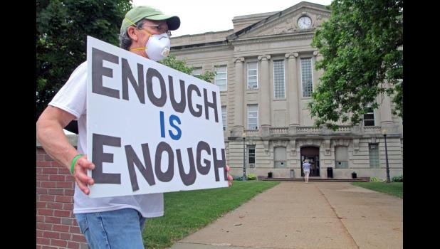 """Steve Eck, a visiting nurse anesthetist at the Greene County Medical Center, participates in the June 9 march. """"It's long overdue,"""" Eck said. """"George (Floyd) might not have been a perfect guy, but no one deserves to die the way he did."""""""