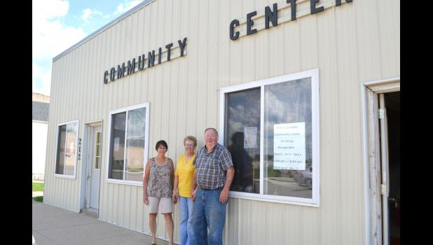 Diane Wise (from left), Shirley Herrick and Gerold Herrick stand outside the century-old Grand Junction Community Center that will be closed in August due to invasive mold.