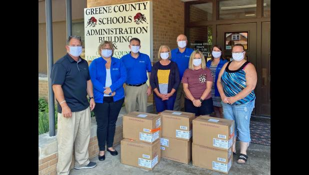 Peoples Bank on Friday made a donation of 3,000 masks to Greene County Schools. The bank has donated more than 10,000 masks regionally to area schools. The cotton masks, which contain silver and copper, can be washed 15 times before being thrown away. CONTRIBUTED PHOTO