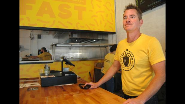 """You want fries with that? Jefferson's Tony Pille stands last week at the counter of Dirt Burger, his vegan fast-food joint in downtown Des Moines that he launched recently with business partner Chris Place, another Jefferson native. """"It's not like Atkins,"""" Pille says of healthy eating. """"It's not a trend. It's here to stay."""" ANDREW McGINN   JEFFERSON HERALD PHOTOS"""