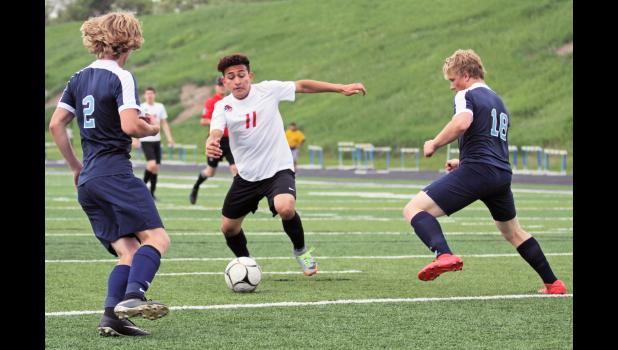 Feet of fury: Greene County High School's Junior Gutierres (center) splits the Unity Christian defense to score a goal in 2018. The Rams prevailed 11-2, with Gutierres scoring four goals. BRANDON HURLEY | JEFFERSON HERALD