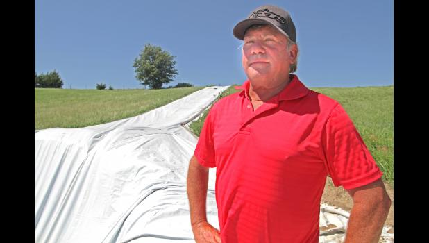 "Craig Flack, pictured with his infamous slip and slide at River Farm Recreation, is fighting for the right to party on multiple fronts. In addition to two separate lawsuits, he's run afoul of the state and is also up against a county rezoning order. ""I'm trying to make an honest living,"" he says. ANDREW McGINN 