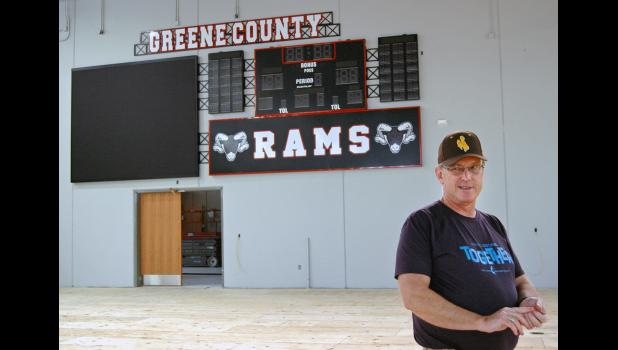 Former longtime school board member Sam Harding, who has overseen construction of the new high school/career academy on behalf of the district, speaks about the building's gym, with the new scoreboard/video board behind him. Once finished, the gym will also boast NBA-caliber backstops donated by AAI/Spalding.