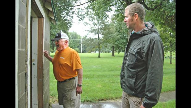 Retired police officer Les Fister (left) and the Rev. Devin Wolters, of the Greene County Homeless Coalition, check for signs of life July 31 in the restrooms at the city park in Scranton. The coalition was conducting its second Point-in-Time Count of the homeless this year, part of a growing trend in rural Iowa. The counties are finding that they all have people who have fallen through society's cracks. ANDREW McGINN | JEFFERSON HERALD