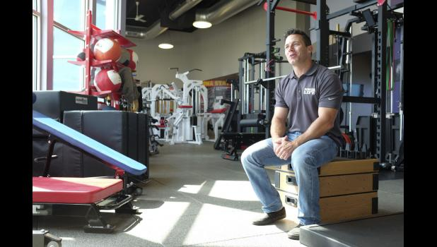 Chris Conner of Power Lift talks about the importance of employees while sitting in the Jefferson company's showroom. JEFF STORJOHANN | JEFFERSON HERALD