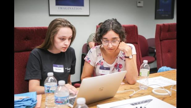 Regan Williams (left) and Elizabeth Wells work together last week to create video games using the programming language Scratch. During a three-day coding camp at Jefferson Telecom that served to expose rural girls to technology careers, girls learned to code in multiple languages. ANNIE MEHL | JEFFERSON HERALD