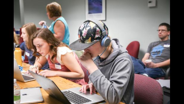 Alisterra Novy, 12, works on designing and building a website during a three-day girls coding camp in Jefferson organized by Linc Kroeger, of Pillar Technology. ANNIE MEHL | JEFFERSON HERALD