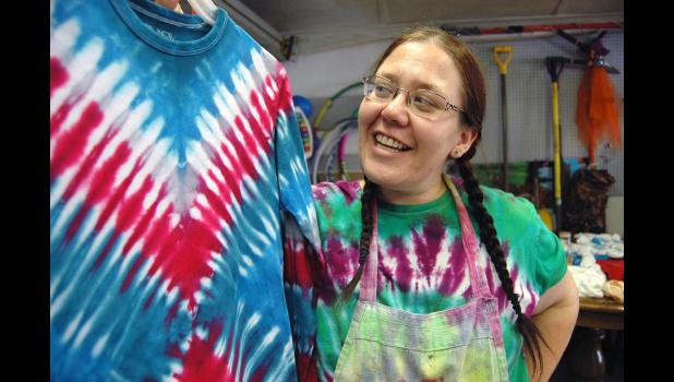 """""""I liked the bright colors. I liked the music. I like being nice to people,"""" says Crystal Dudley, a late-stage Deadhead who recently found she has a knack for making tie-dye clothing. Dudley has been turning out one brightly psychedelic shirt after another in her garage on South Olive Street in Jefferson. She sells her wares at the Greene County Farmers' Market. ANDREW McGINN 