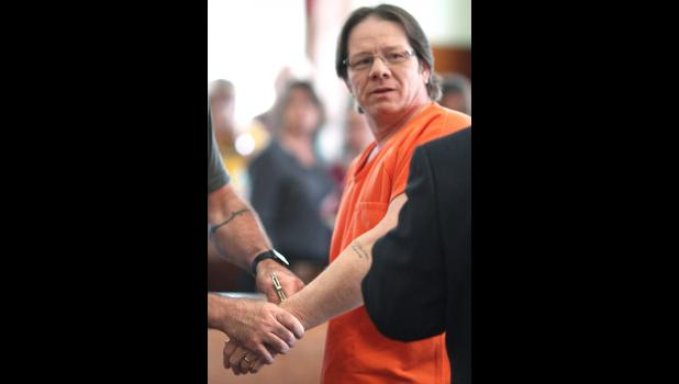 James Exline is handcuffed Aug. 6 after a judge sentenced him to up to 75 years in prison. JARED STRONG | JEFFERSON HERALD