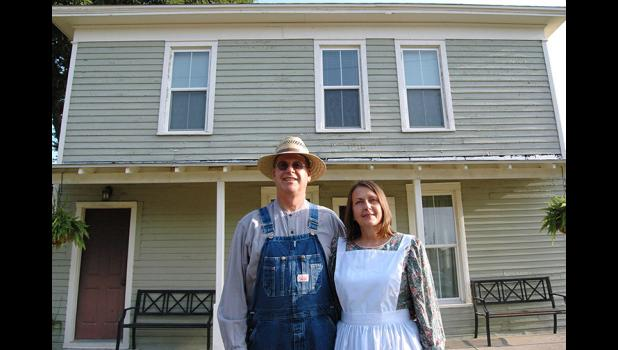 American Gothic: Nick and Annette Foster, long known for their Old-Fashioned Threshing Bee, now have a hotel to accompany their love of history. The Fosters are the new owners of a hotel, the Mason House on Lincoln Highway, that first welcomed guests in the late 1800s. ANDREW McGINN | JEFFERSON HERALD
