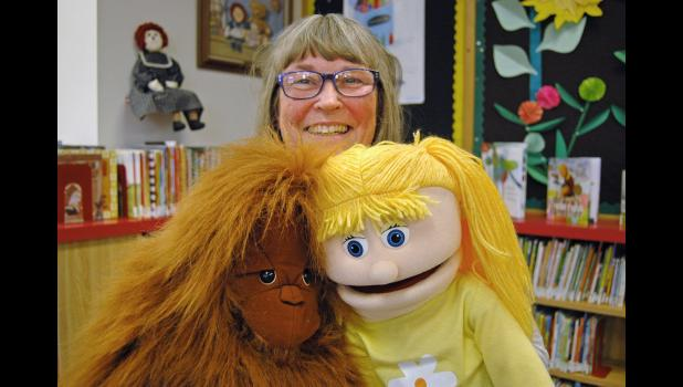 """""""The library was a place of reverence when I was a kid,"""" says Terry Clark, who is retiring as assistant director and children's librarian at the Jefferson Public Library. """"We've evolved."""" Clark and her many puppets helped turn the local library into a place of fun. ANDREW McGINN   JEFFERSON HERALD PHOTOS"""