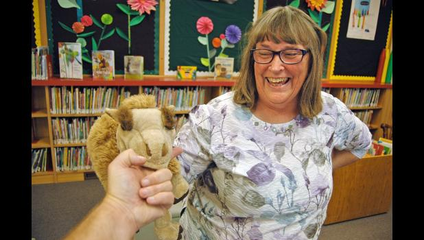 """One of Terry Clark's puppets bites the photographer at the Jefferson Public Library. """"She's a very loving person, and the kids sense that,"""" library director Jane Millard says of Clark, the library's retiring assistant director and children's librarian. ANDREW McGINN   JEFFERSON HERALD PHOTOS"""