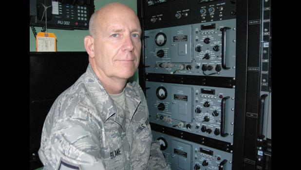 Larry Blake, new commander of Jefferson's American Legion Post 11, works with the latest communications equipment in his job with the Iowa Air National Guard.