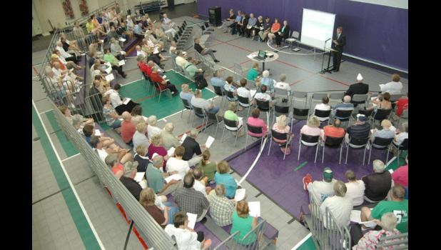 A crowd gathered Monday night at the Greene County Community Center to hear about ongoing building projects and a predicted surge locally in new jobs.