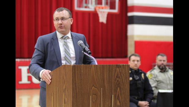 """We need to evaluate, as a state, our prison system and our laws,"" says County Attorney Thomas Laehn, pictured speaking in March at Greene County Middle School's DARE graduation. ""We need to have a serious conversation about the legalization of marijuana."" The state prison system is already at 124 percent capacity, he says, leading the state to recommend probation for most cases. ANDREW McGINN 