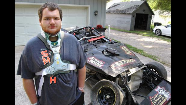 """""""A lot of people thought I was dead,"""" says Jon Strabley, 20, pictured at home in Grand Junction with the remains of his race car. A terrifying crash on July 13 ended his rookie season of dirt-track racing and nearly claimed his life. ANDREW McGINN 