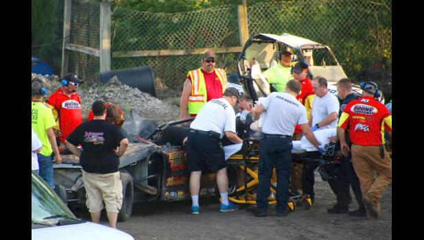 First-responders at the Boone Speedway work to pull Strabley from his car after his brakes failed, causing him to launch over the side of the track and roll multiple times. CARLA SHEPPARD PHOTO