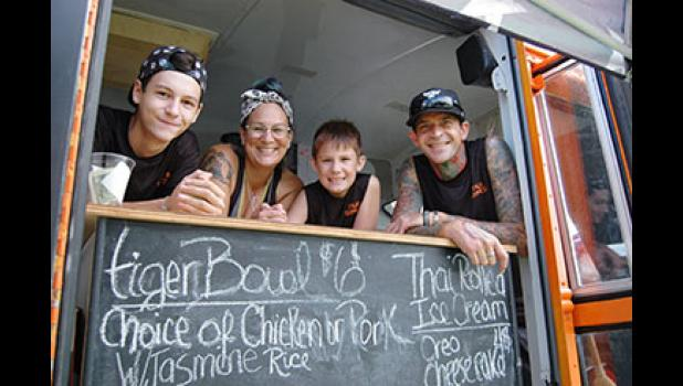 Nicole Murphy, her sons Scott Broadbent (far left) and Sean Murphy (third from left), along with good friend William Griffin (far right), have hit the streets with Jefferson's first food truck, Tiger Express. ANDREW McGINN | JEFFERSON HERALD PHOTOS