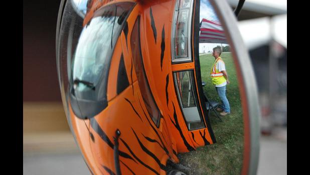 An Iowa Department of Transportation worker orders her lunch last week at Tiger Express, which was parked outside Tri-County Lumber.