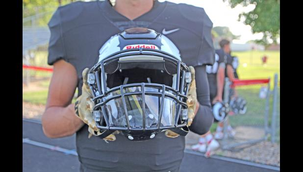 Greene County High School's football helmets will look a little different this fall. The Rams have installed plastic shields meant to redirect infectious droplets from natural breathing, engineered and donated by Iowa State University. BRANDON HURLEY | JEFFERSON HERALD