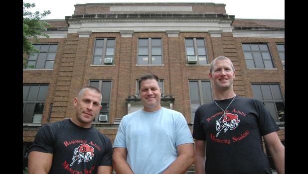 """Great people come from all aspects of life,"" says Jeff Cunningham (left), who is leading a new program, Responsible Adults Mentoring Students (R.A.M.S.), at Greene County elementary and middle schools with the Rev. Devin Wolters (far right). They're pictured with middle school Principal Shawn Zanders. The program replaces the male-only Watch D.O.G.S., and is open to men and women alike. ANDREW McGINN 